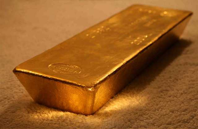 Whole Gold Bar on Grey Carpet