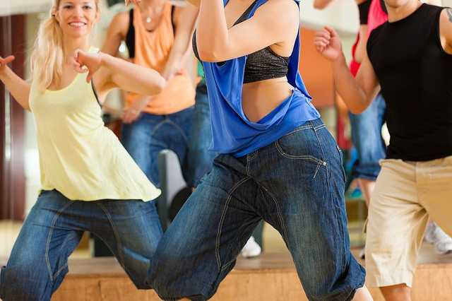 Zumba Or Jazzdance - Young People Dancing In A- Studio Or Gym Doing Sports Or Practicing A- Dance